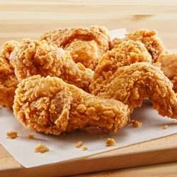 crispy coated batter southern style fried chicken in a wooden table